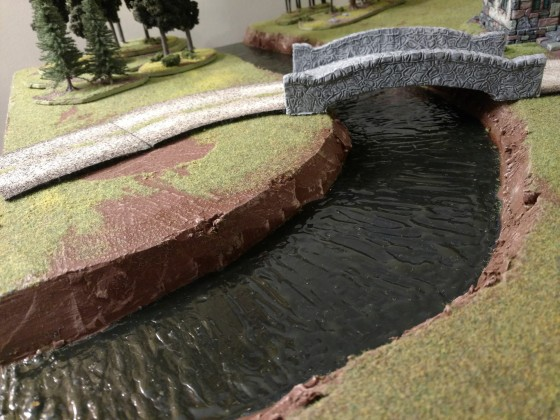 Modular river terrain board with water effects using Mod Podge acrylic gloss sealer