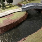 Modular river terrain board with water effects using Mod Podge acrylic gloss sealer