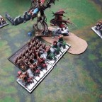 Crusher Knights and Dragon Centaurs charge a Warrior block
