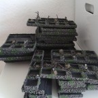 Pile of new movement trays