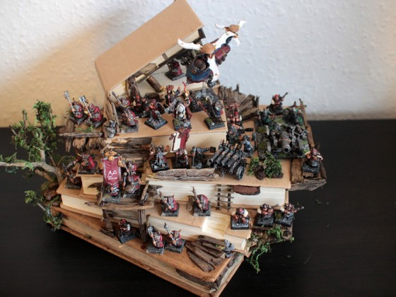 Dwarven hold army sitting on carved ancient grudge books